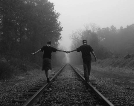 LOVERS ON RAILROAD TRACKS