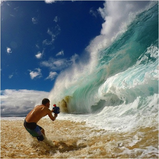 Clark Little shooting a wave in Hawaii, www.clarklittlephotography.com