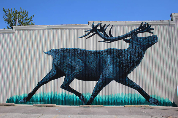 Mountain caribou mural in Sandpoint, Idaho, by Mazatl & Joy Mallari